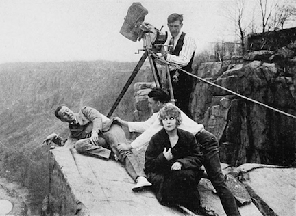 "HOUSE OF HATE director George B. Seitz hangs over the edge of ""Cliffhanger Point"" while Pearl White and Antonio Moreno watch. That's future Oscar-winning cinematographer Arthur Miller at the camera."