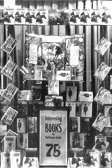 Display of Mundy's books in store window.