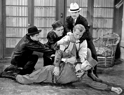 Brix has his hands on Bela Lugosi, whose henchmen intervene in SHADOW OF CHINATOWN.
