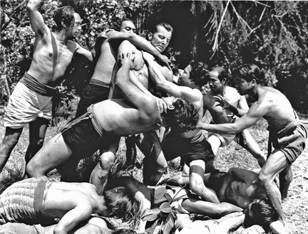 Brix fighting off Guatemalan natives in NEW ADVENTURES OF TARZAN.